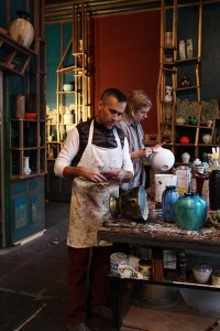 Waterston and assistant priming and painting ceramics