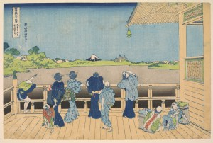 Several men and women look out from a wooden porch; some rest their arms on the railing. Others include a child holding a woman's hand and two people sitting down on the porch. A small mountain looms in the distance beyond the railing.