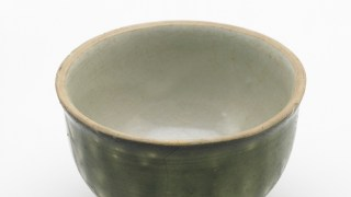 Stone cup with white slip under colorless and copper-green glazes