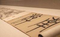 Scroll with calligraphy in Chinese seal script.