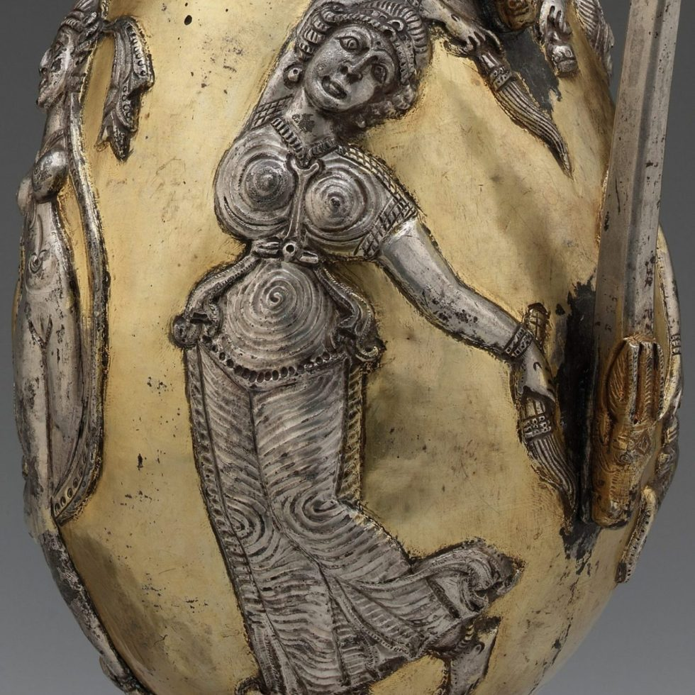 Decorated ewer showing a woman wearing a garment