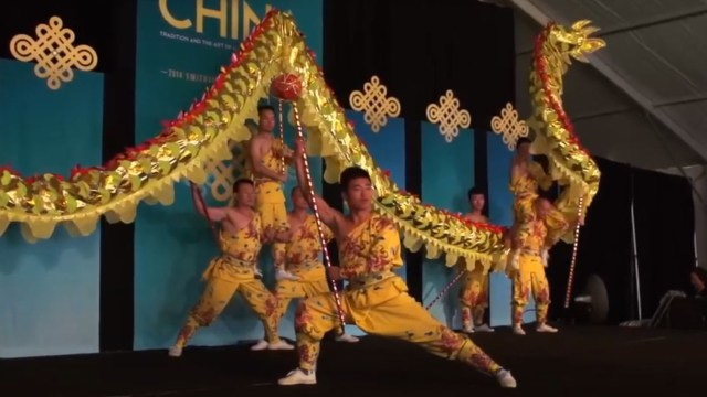 men dancing on stage in yellow