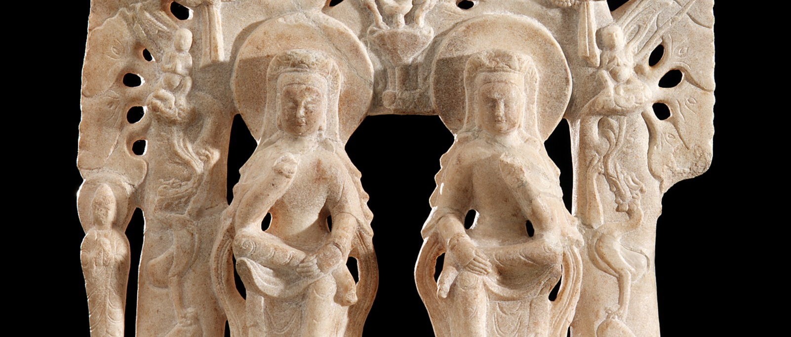 stone carving of 2 people
