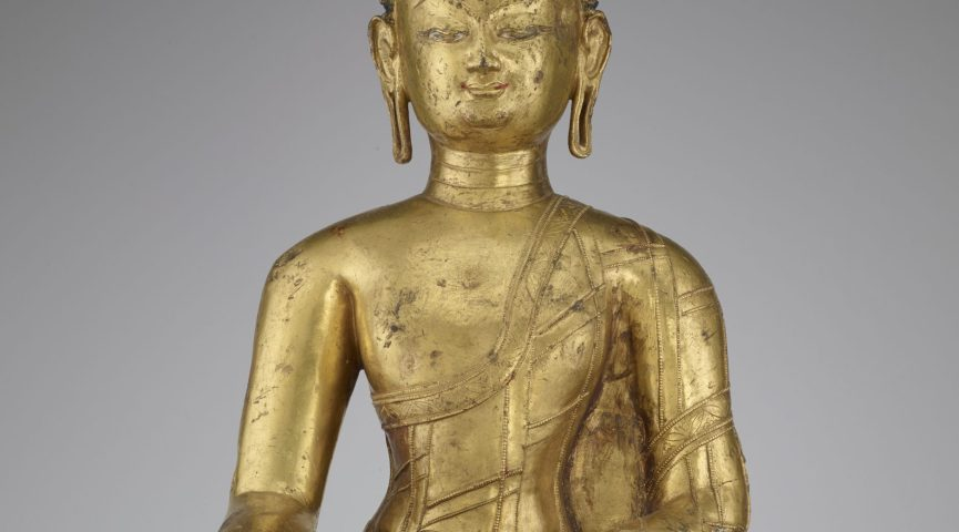gold statue of sitting Budda with blue hair
