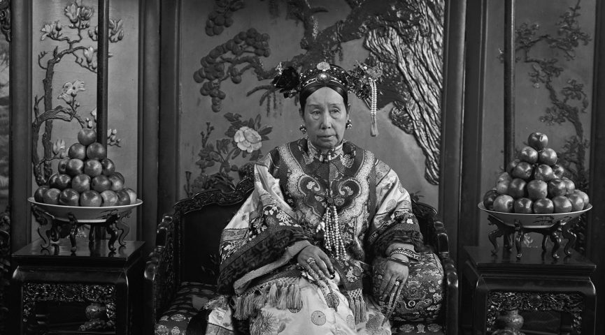 photo of empress sitting on a throne holding a statue