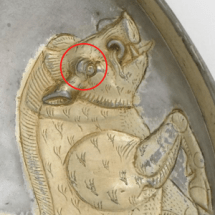 Close up of boar on Shapur plate with red circle around its wide open eye