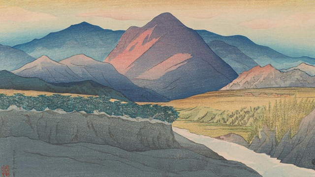 Detail of a woodblock print of a mountain, standing out in shades of pink and purple against the serene blue mountains behind it, a field with a brook stretching out to the viewer from this midground