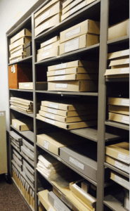 Archival boxes on shelves.