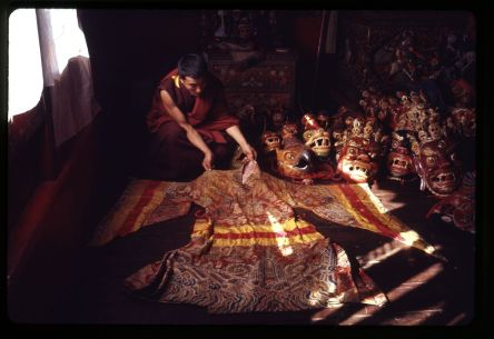 Kandell, Alice S, photographer. Lama displaying brocaded robe and masks for the New Year's ceremony at the Tsuklakhang Main Temple Palace Temple, Gangtok, Sikkim. Gangtok, India, January 1969. Photograph. https://www.loc.gov/item/2011646340/.