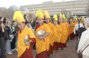 A profession of monks through the Smithsonian gardens outside the museum.