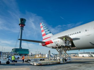 Heathrow, Terminal 3, Pier 5, cargo being unloaded from American Airlines