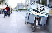 Amazon concedes in China e-commerce battle