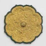 Foliated mirror with birds and floral scrolls, China, early or mid-Tang dynasty, late 7th or early 8th century, cast bronze and applied gold plaque with repoussé, chased and ring punched decoration