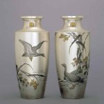 Pair of vases decorated with wild geese by Tsukada Shukyo (1848-1914), commissioned by the Imperial Household, cloisonné enamel, silver, gold, circa 1910, height 34.7 cm © The Khalili Collections of Japanese Art