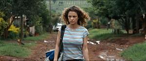 PAULINA_still_woman_walking_down_dirt_roadadj