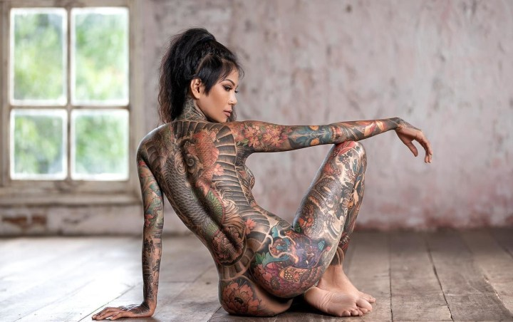Sour heart inked Thai babe