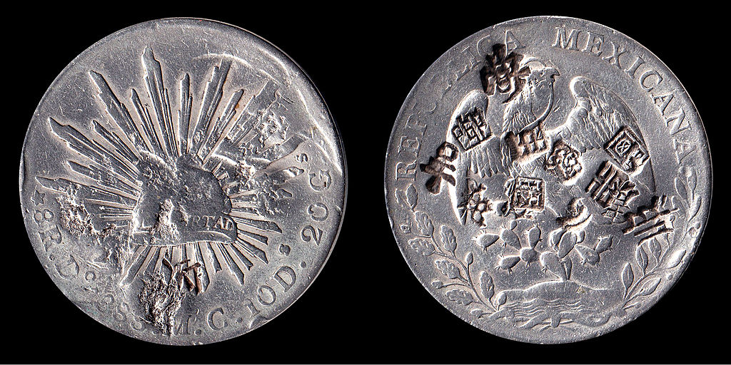 Mexican silver dollar with Chinese chops (via Wikimedia Commons)