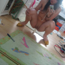 Asian teen plays with dildo in front of mirror