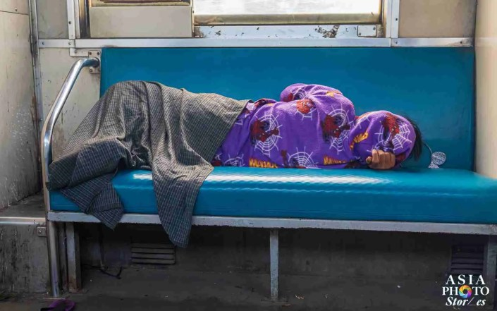 On a train that takes four hours to circle Yangon, sometimes the only way to pass the time is sleep.
