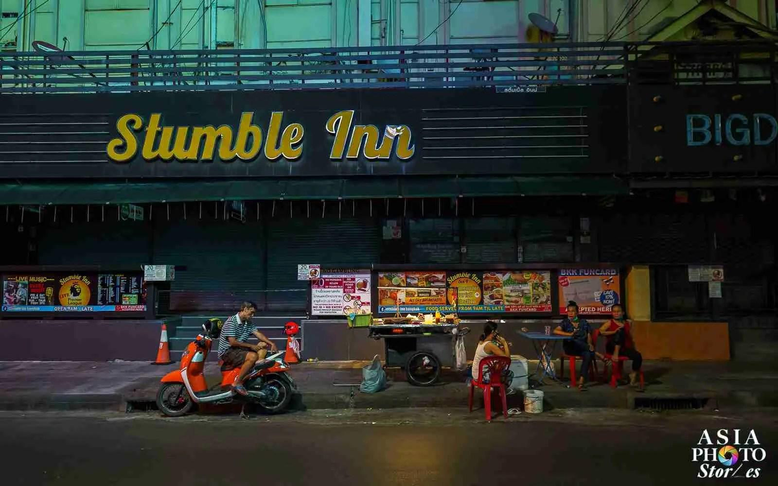 A single street vendor remains outside the closed Nana Plaza adult entertainment complex on Sukhumvit Soi 4 in Bangkok.