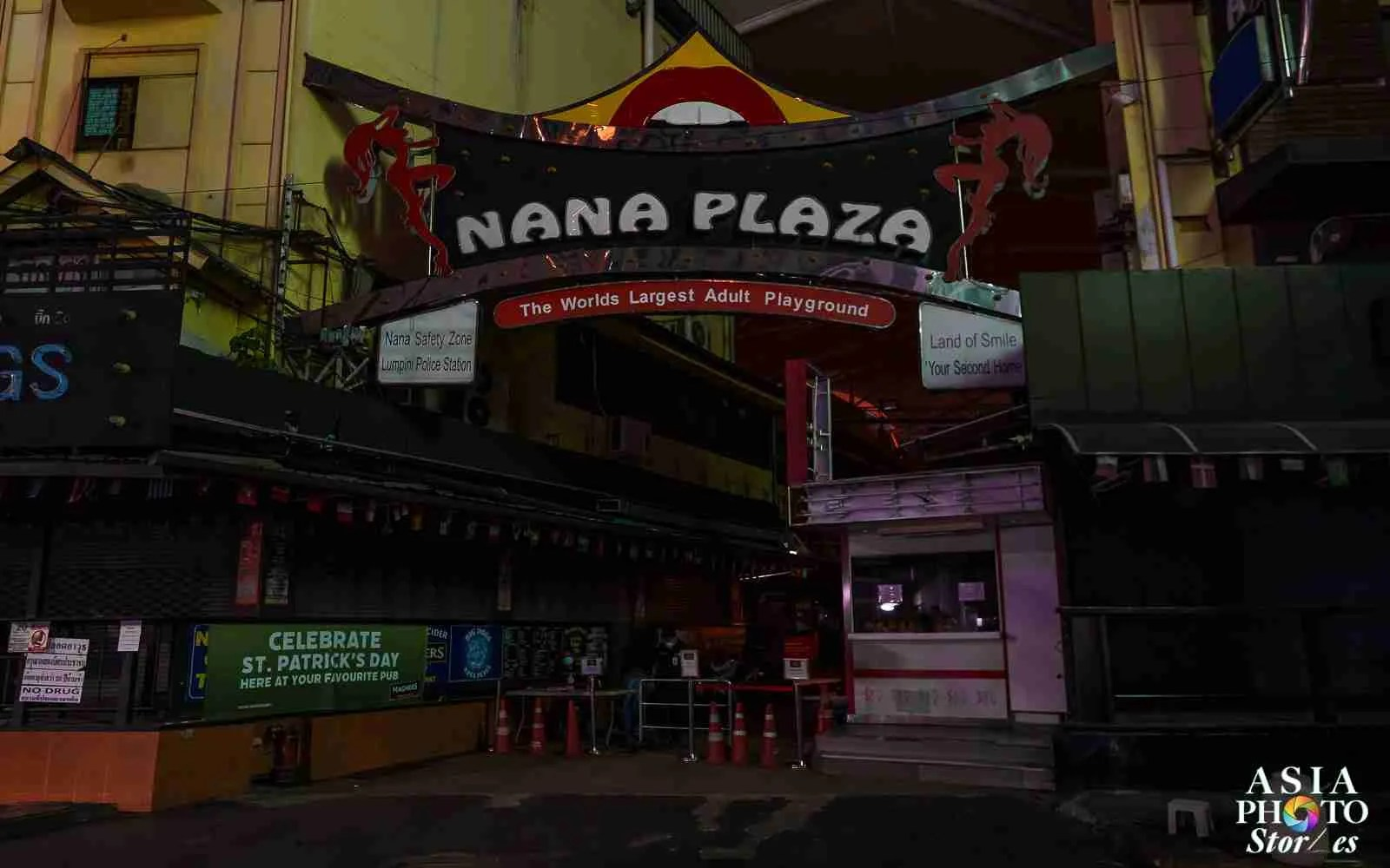Two security guard keep watch outside a closed Nana Plaza adult-entertainment complex on Bangkok's Sukhumvit Soi 4 on April 2.