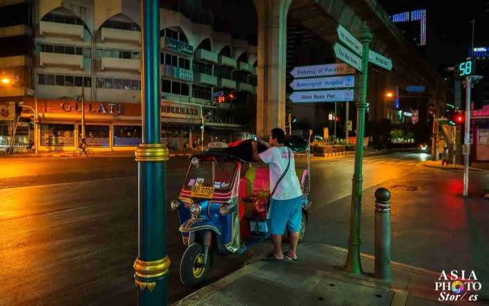 A solitary tuk-tuk driver looks around the deserted streets of Bangkok's Nana red light district, hoping for a customer on April 2.