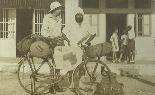 Late N. Gurdial Singh Gill in front of the Clive Institution Rawang with a round-the-world cyclist from Australia in late 1950s. -- PHOTO COURTESY OF MALKEET