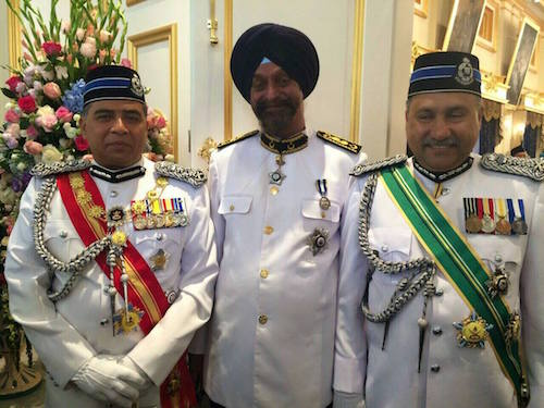 Dr Harjit Singh with Malaysia's Inspector-General of Police Khalid Abu Bakar (left) and Johor state police chief Mohd Mokhtar Mohd Shariff at the coronation of the Sultan of Johor