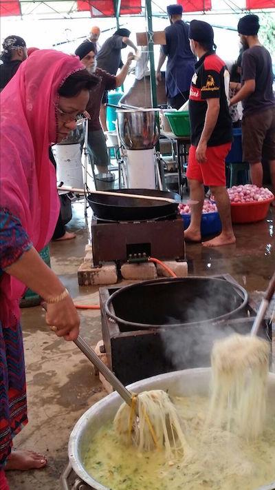An Indonesian Sikh preparing vegetarian soto at the Malacca annual Sikh prayer programme - PHOTO SARJIT KAUR