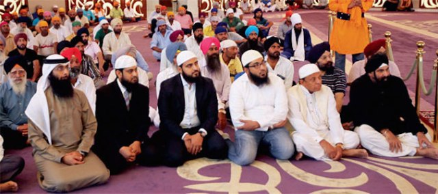 Guests from Al Manar Islamic Centre attend the Maghrib prayer at Guru Nanak Darbar at Jebel Ali in Dubai on Tuesday. - PHOTO COURTESY OF KHALEEJ TIMES