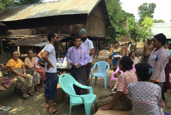 Myanmar Young Sikh Aid doctor inspecting patients at one of the villages - PHOTO MYSA