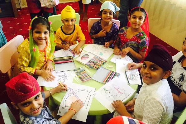NEW LIBRARY: Kids at the newly launched library at Wadda Gurdwara Sahib Ipoh. - PHOTO COURTESY WGSI
