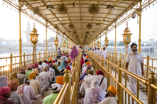 Sikh devotees on the causeway to the Darbar Sahib at the Golden Temple in Amritsar - RAZY SHAH / LITTLE INDIA DIRECTORY