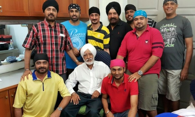 Teja Singh (seated, white turban) with some of the local Malacca boys at the Gurdwara Sahib Malacca office - PHOTO / SUPPLIED