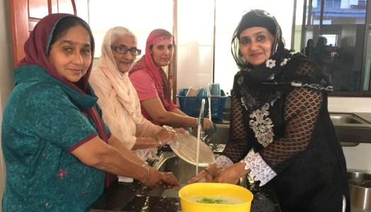 LADY POWER: Some of the ladies cleaning the utensils at Gurdwara Sahib Kuala Pilah - PHOTO / ASIA SAMACHAR