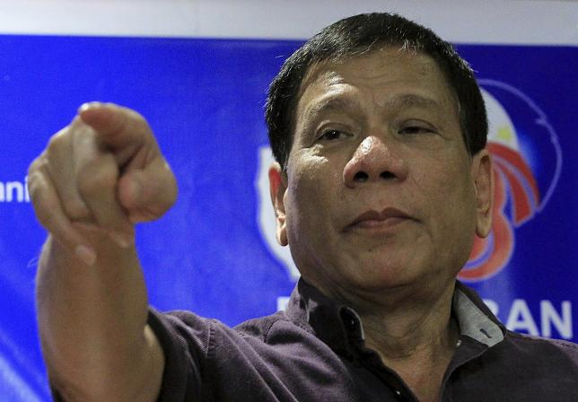 Then presidential aspirant Rodrigo Duterte points during a press conference in a November 30, 2015 file photo. Photo: Reuters/Romeo Ranoco