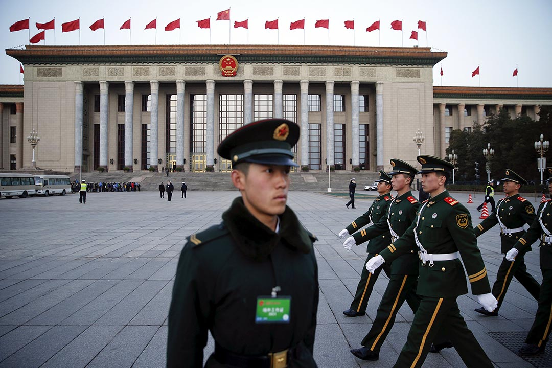 China's armed police are seen outside the Great Hall of the People. Beijing says its defense budget is 1.1 trillion yuan this year, but it tends to 'cook the books' when it comes to actual outlays. Photo: AFP