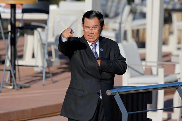Cambodia's Prime Minister Hun Sen gestures as he arrives for a family photo with other ASEM leaders outside Ulaanbaatar.   Photo: Reuters/Damir Sagolj