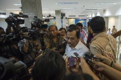 Indonesia's Attorney General H.M. Prasetyo speaks to reporters at the presidential palace in Jakarta