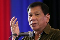 Philippine President-elect Rodrigo Duterte speaks during a conference with businessmen in Davao