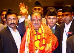 Nepal's newly elected Prime Minister Pushpa Kamal Dahal, also known as Prachanda, waves towards the media after he was elected Nepal's 24th prime minister in 26 years, in Kathmandu