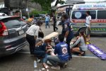 Injured people receive first aid after a bomb exploded on August 11, 2016 in Trang