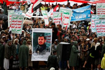 Supporters of Houthi rebels and Yemen's former president Ali Abdullah Saleh hold a poster of the Houthi movement's leader, Abdulmalik Badruddin al-Houthi, during a rally in Sanaa, Yemen