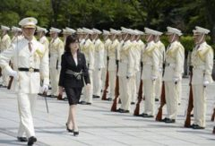 apan's defence minister Tomomi Inada reviews a guard of honor at the Ministry of Defense in Tokyo