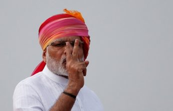 Indian Prime Minister Modi gestures as he addresses the nation from the historic Red Fort during Independence Day celebrations in Delhi