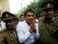 Namal Rajapaksa, son of former Sri Lanka's President Mahinda Rajapaksa, leaves with prison officers at the court after being arrested in Colombo
