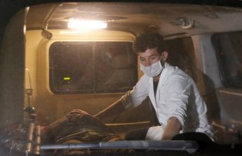 A wounded man lies inside an ambulance following an attack at American University of Afghanistan in Kabul