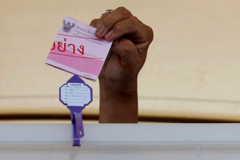 hailand Election Commission's chairman Supachai Somcharoen holds a ballot during an event to promote voting at the next August 7 referendum over military-back draft constit