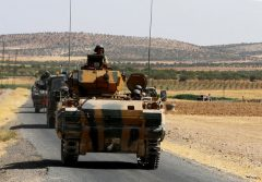 A Turkish army convoy drive from the border back to their base in Karkamis on the Turkish-Syrian border