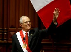 Peru's President Pedro Pablo Kuczynski waves to the audience after receiving the presidential sash during his inauguration ceremony in Lima